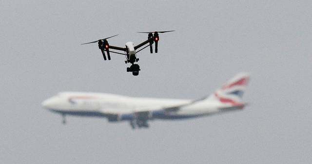 UPDATE - UK police arrest man and woman over Gatwick drone disruption