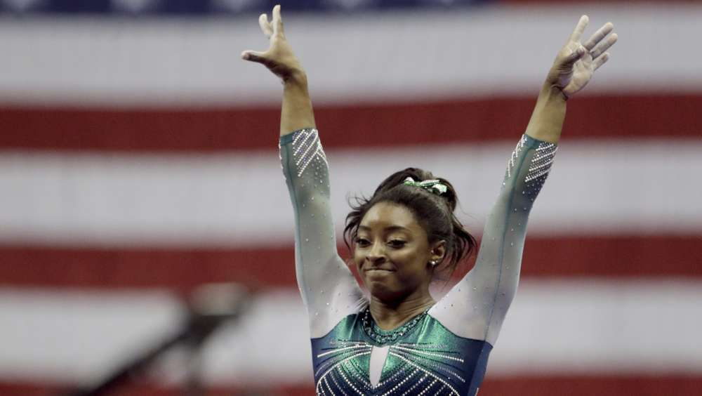 Gymnastics-Biles dazzles on floor to win record 25th world championship medal