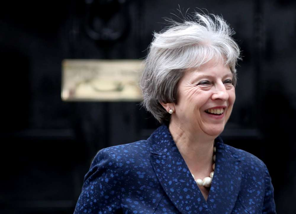 May seeks unity amid chaos over Brexit plans