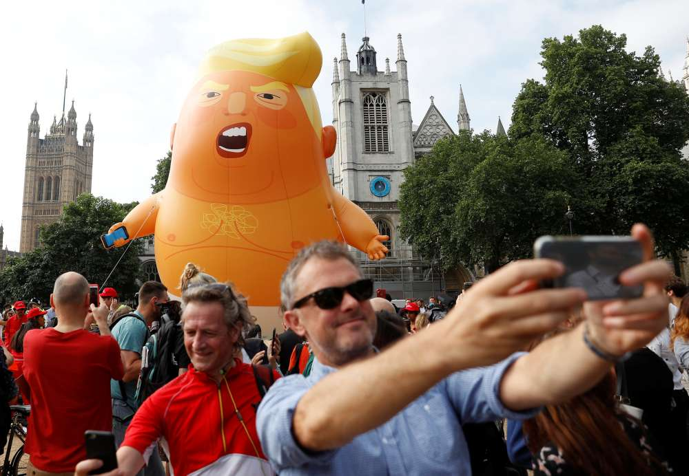 Trump opponents inflate snarling orange