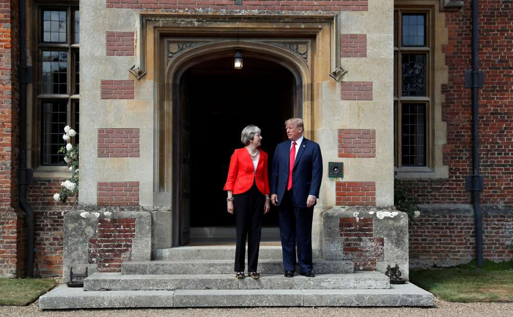 Trump praises strong relationship with May after damning her Brexit plan