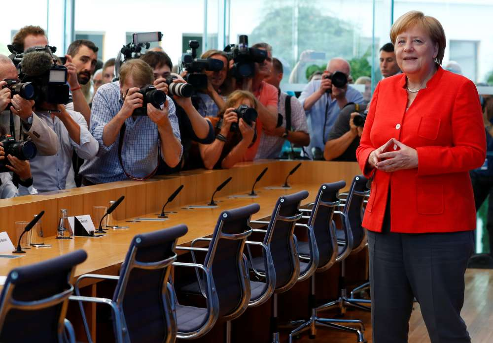 Merkel vows to stay in job