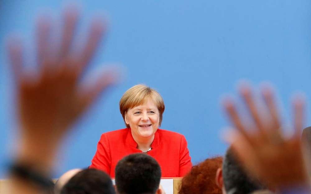 Merkel says EU should meet existing emissions aims