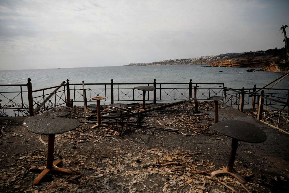 Wildfires kill at least 74 near Athens