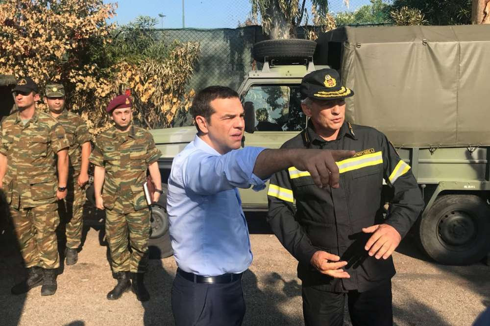 Greek PM visits wildfire-stricken town after criticism