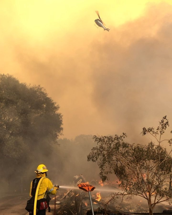 Crews gain on California wildfire as milder temperatures prevail