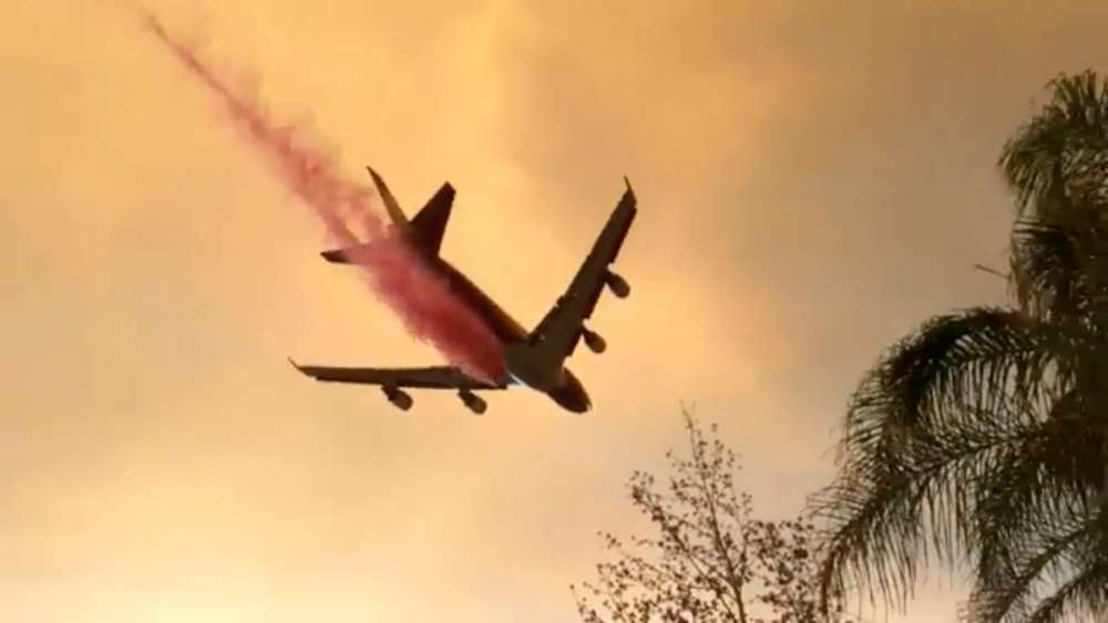 Aggressive wildfire threatens thousands of homes in southern California city
