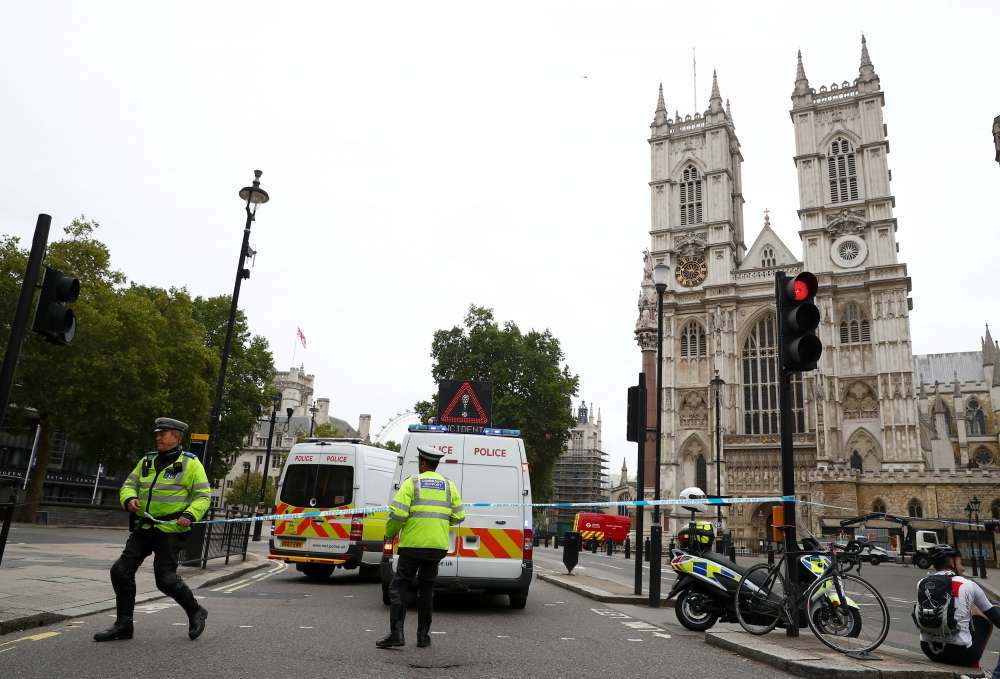 Man held for terrorism after driving into UK parliament barriers