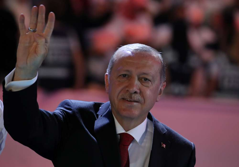 Erdogan says attack on economy no different from attack on flag