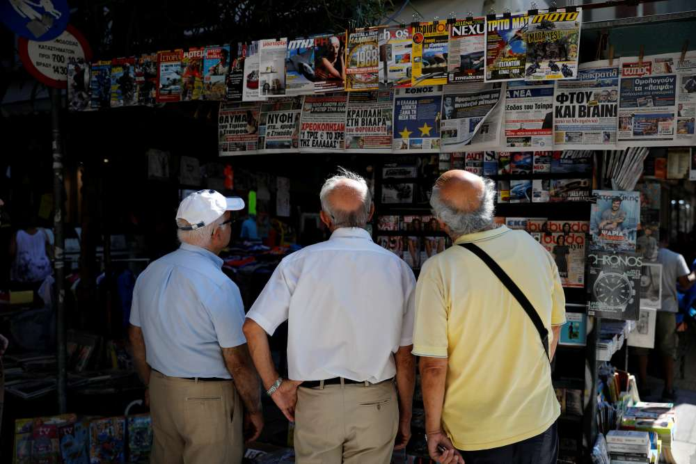 Greece ends bailout odyssey but Athens not in festive mood