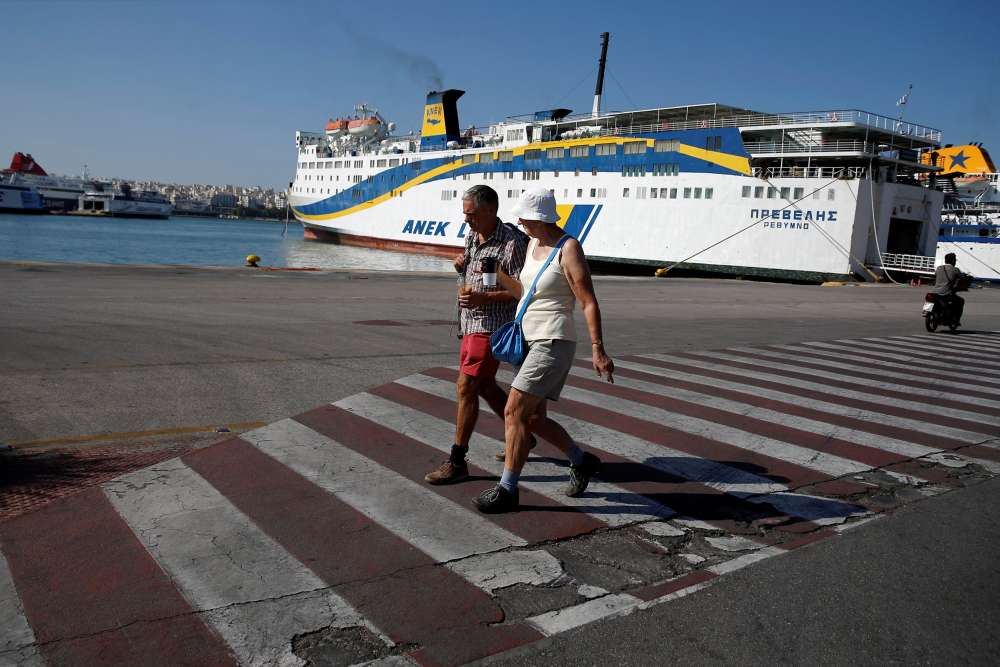 Greek ships remain docked at ports after seamen extend strike