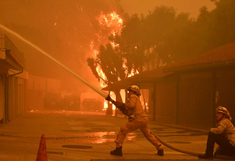 Troops sift through ruins as California wildfire death toll rises; 56 dead