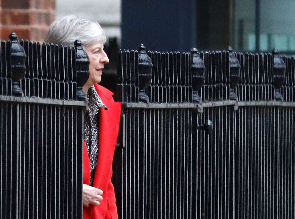 May defends Brexit deal as talk of no-confidence vote grows
