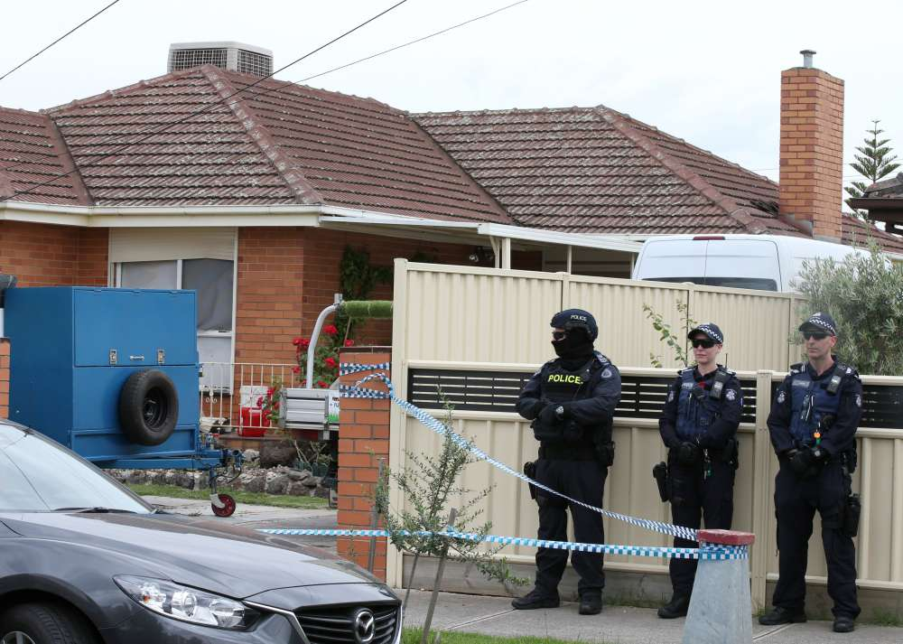 Australian police charge three men over plot to undertake 'mass' attack