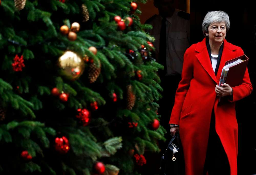 May's Brexit deal under fire as legal advice stiffens opposition