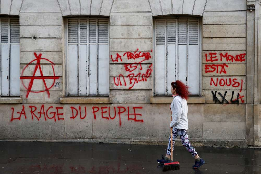 Macron must unify France as unrest is hurting economy - Le Maire