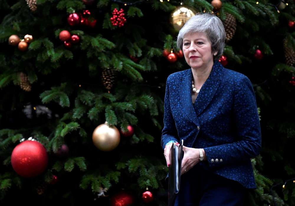 May vows to fight on