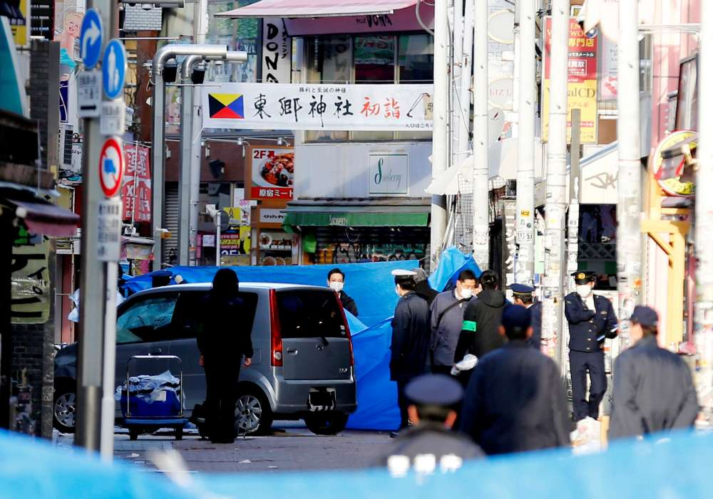 Car crashes into New Year's crowd in Tokyo in suspected terror attack