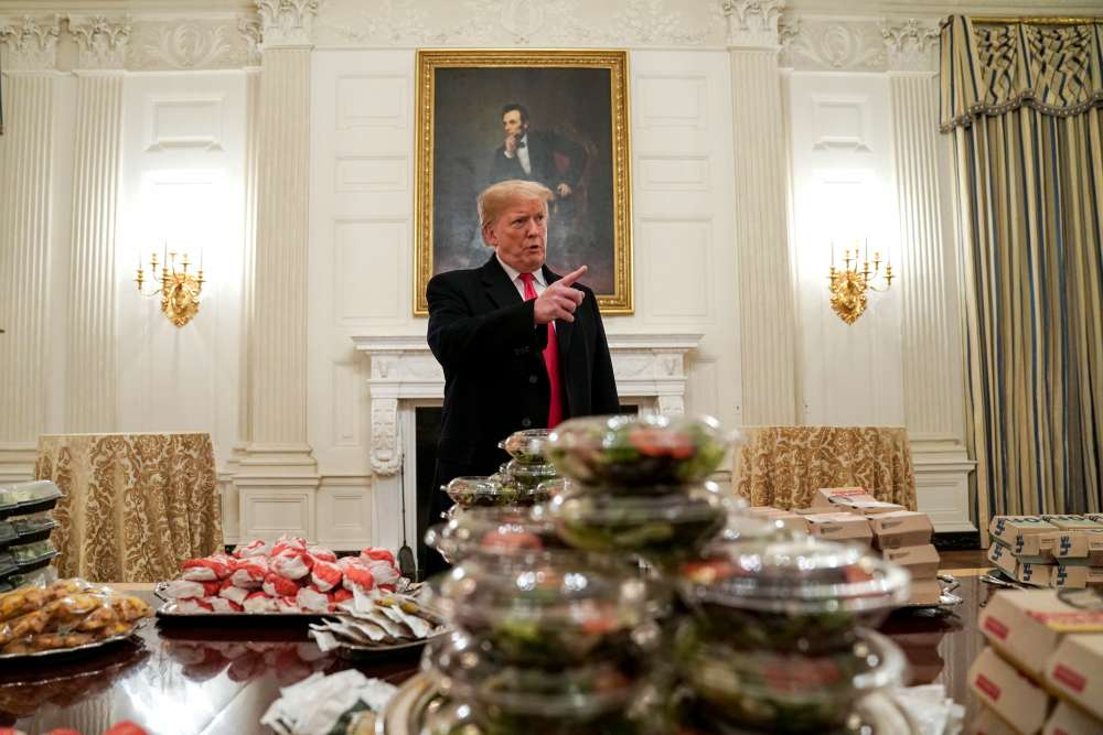 Burgers by candlelight: Trump lays out fast food for college football champs