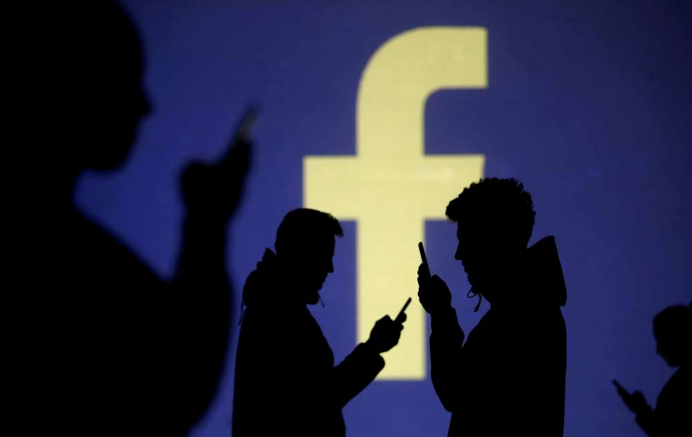 Facebook rejects co-founder call for breakup