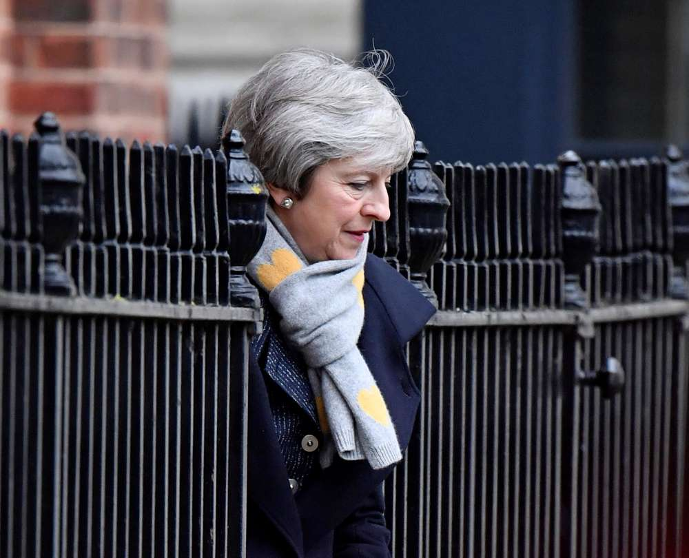 Britain's May says she will quit if her Brexit deal passes