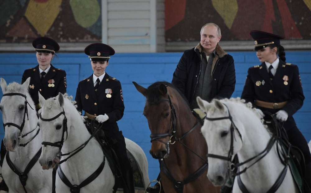 Putin rides horse with female police ahead of International Women's Day (video)