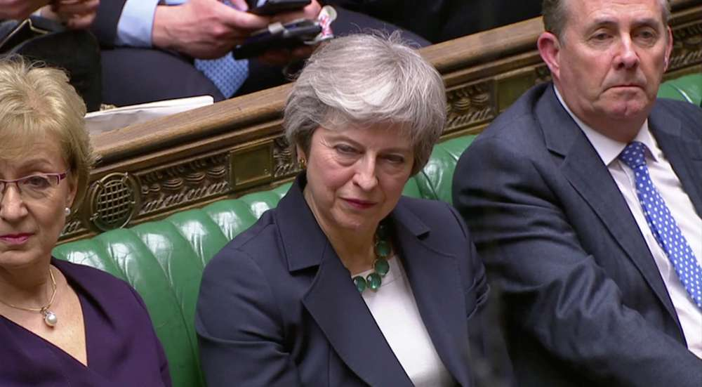 Death knell for May's Brexit deal: lawmakers reject it 344 to 286