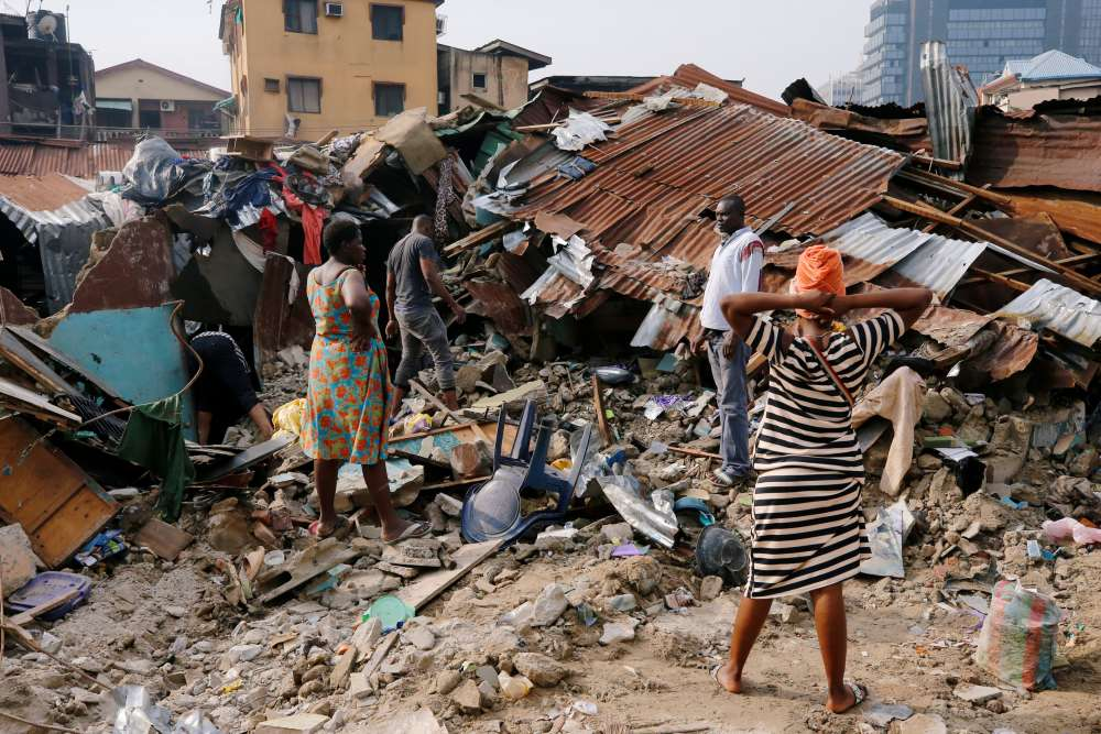 Rescuers try to account for children after Nigerian school collapses