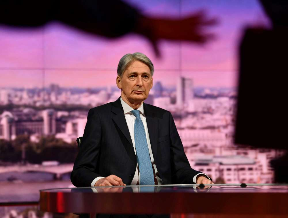 Hammond: Britain must resolve Brexit but changing PM May wouldn't help