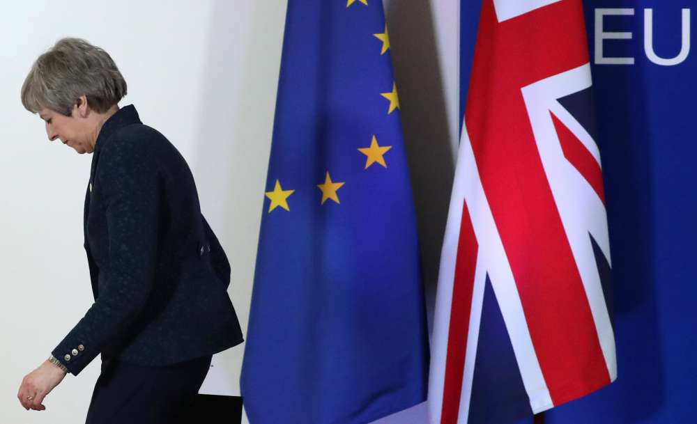 May gets two-week Brexit reprieve from impatient EU