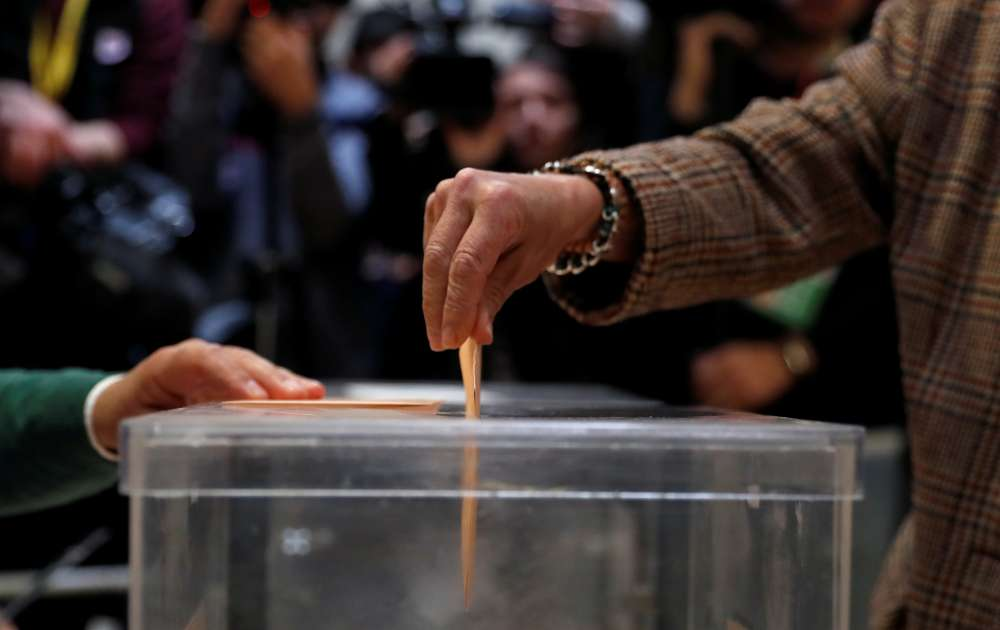 Voting starts in Spain with suspense high after tense campaign
