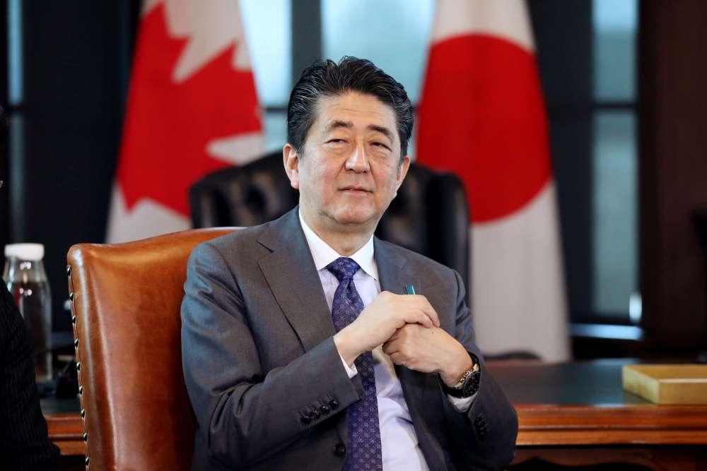 Japan's Abe signals shift on N.Korea
