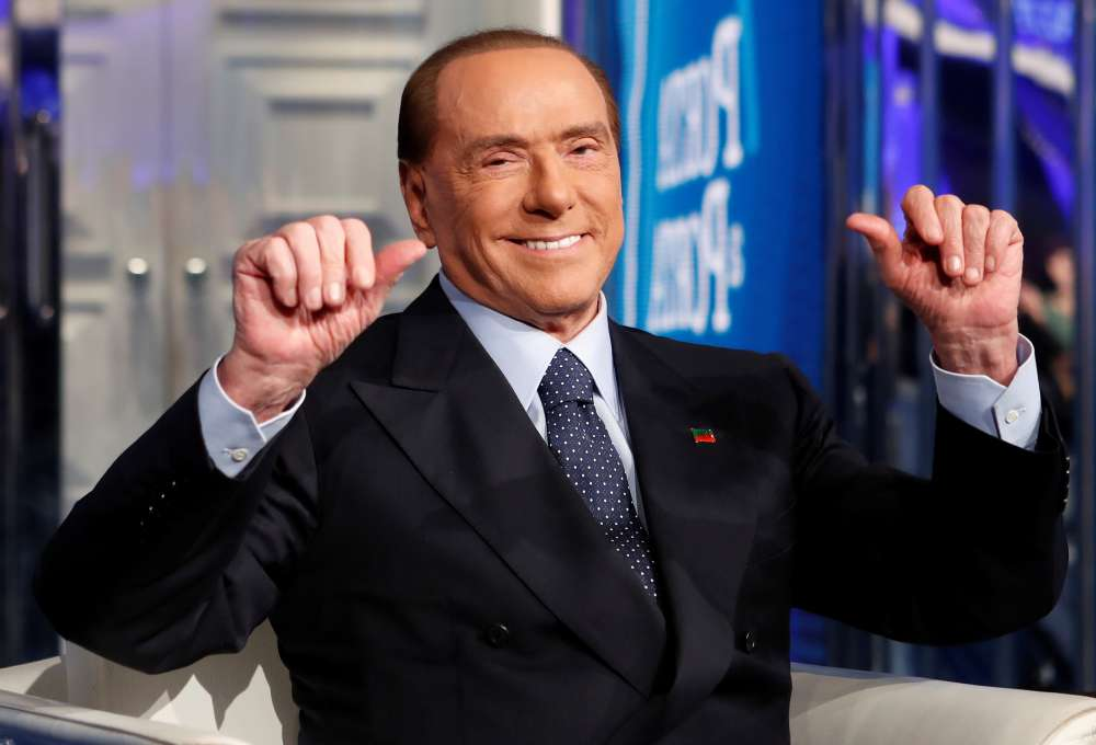Italy's Berlusconi hospitalised but vows to resume campaign