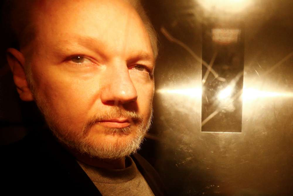 Julian Assange sentenced to 50 weeks in British jail for skipping bail