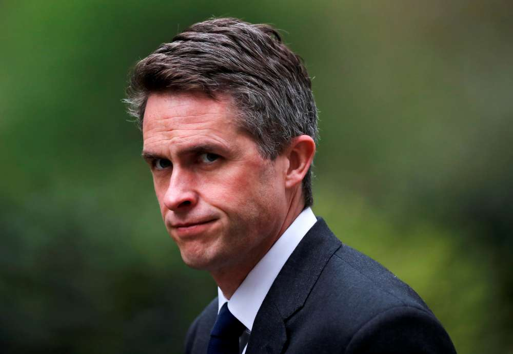 UK's May fires defence secretary over Huawei leak