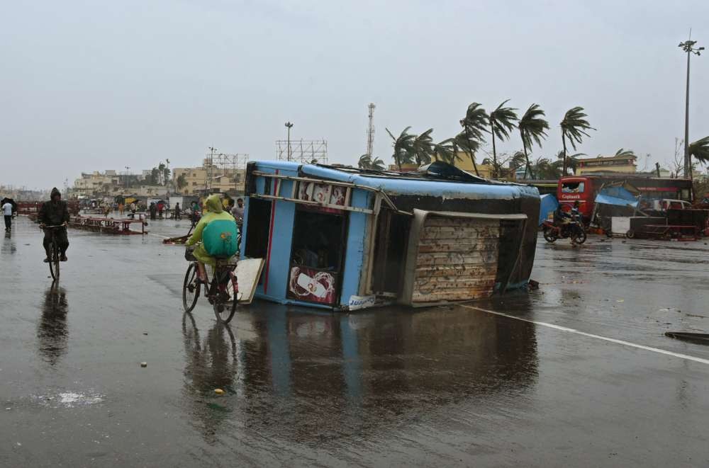 Strongest cyclone in five years kills at least 12 in India before swiping Bangladesh