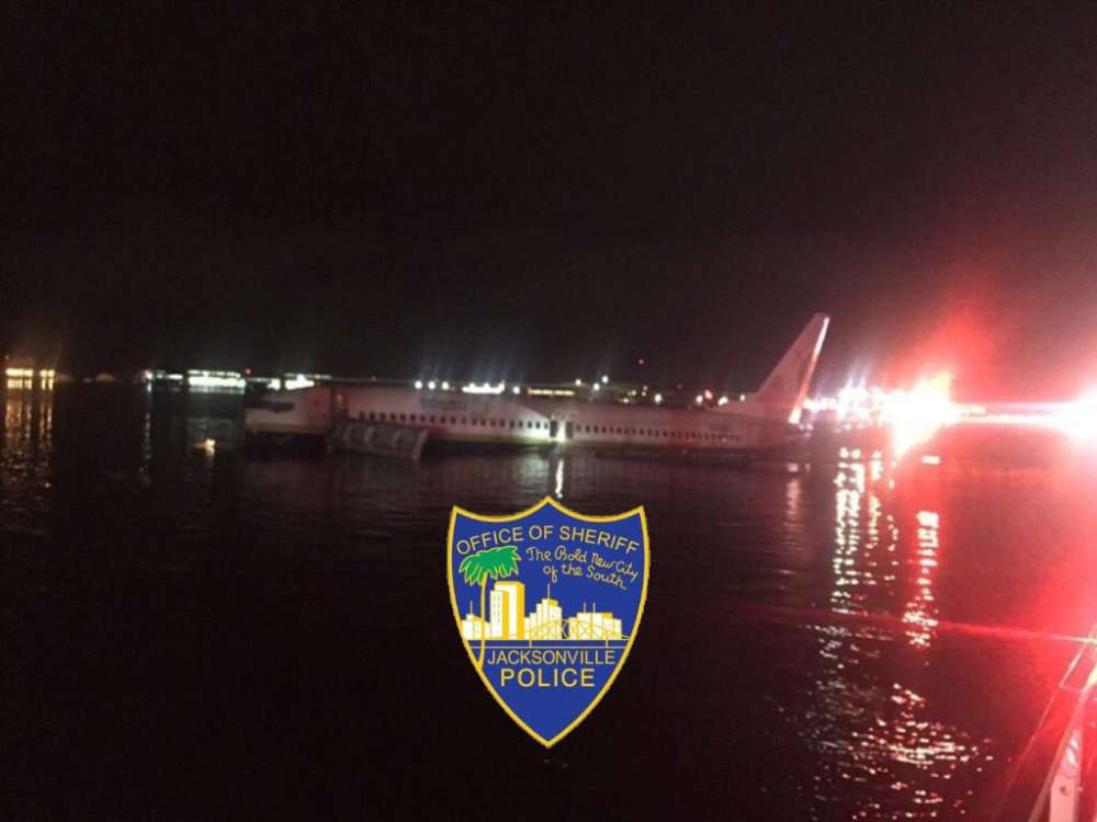 Boeing 737 slides off runway into Florida river