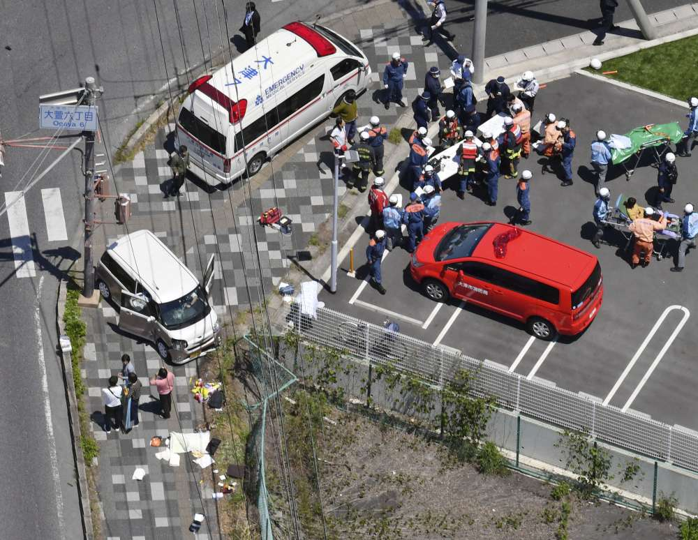 Two children killed in Japan after car rams into group