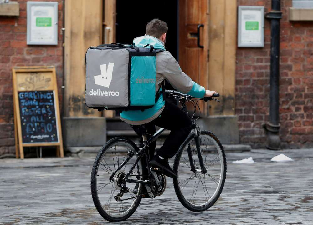 Amazon squares up to Uber with backing for UK food app Deliveroo