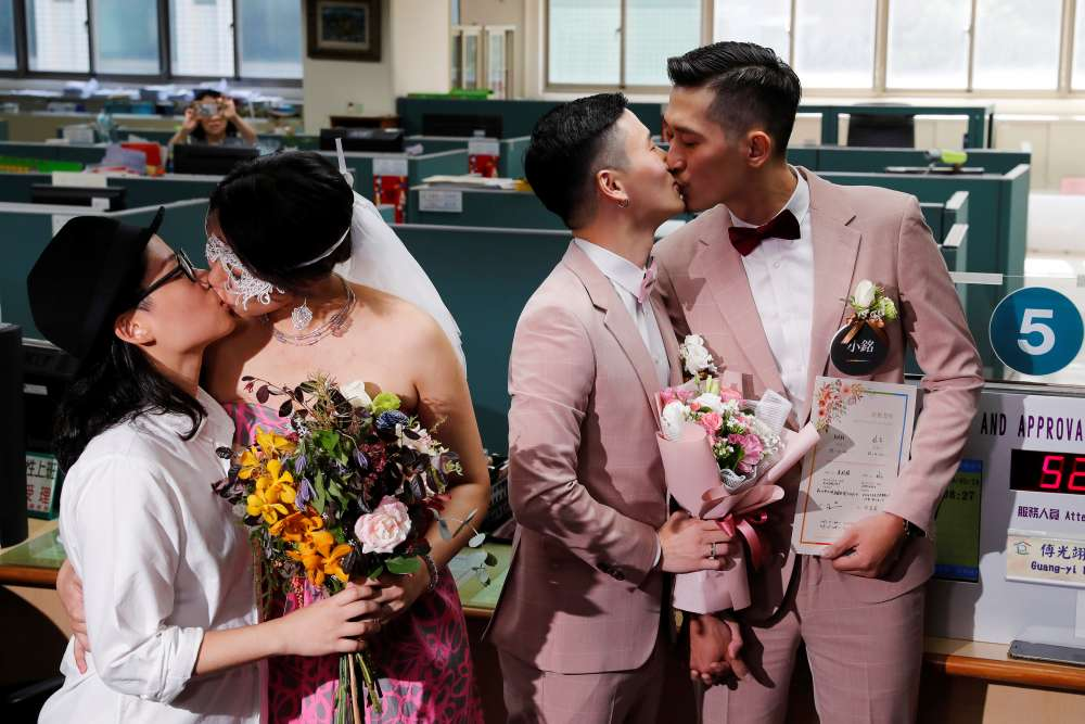 Taiwan celebrates Asia's first same-sex marriages as couples tie knot