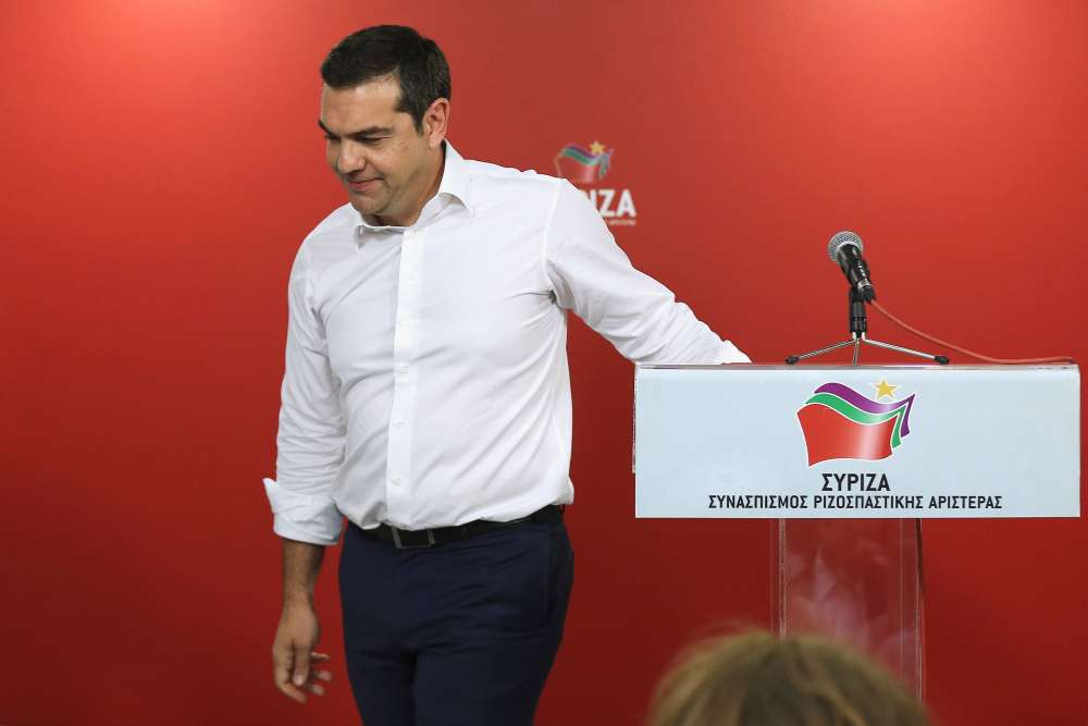 Greek PM calls snap vote after drubbing for ruling Syriza