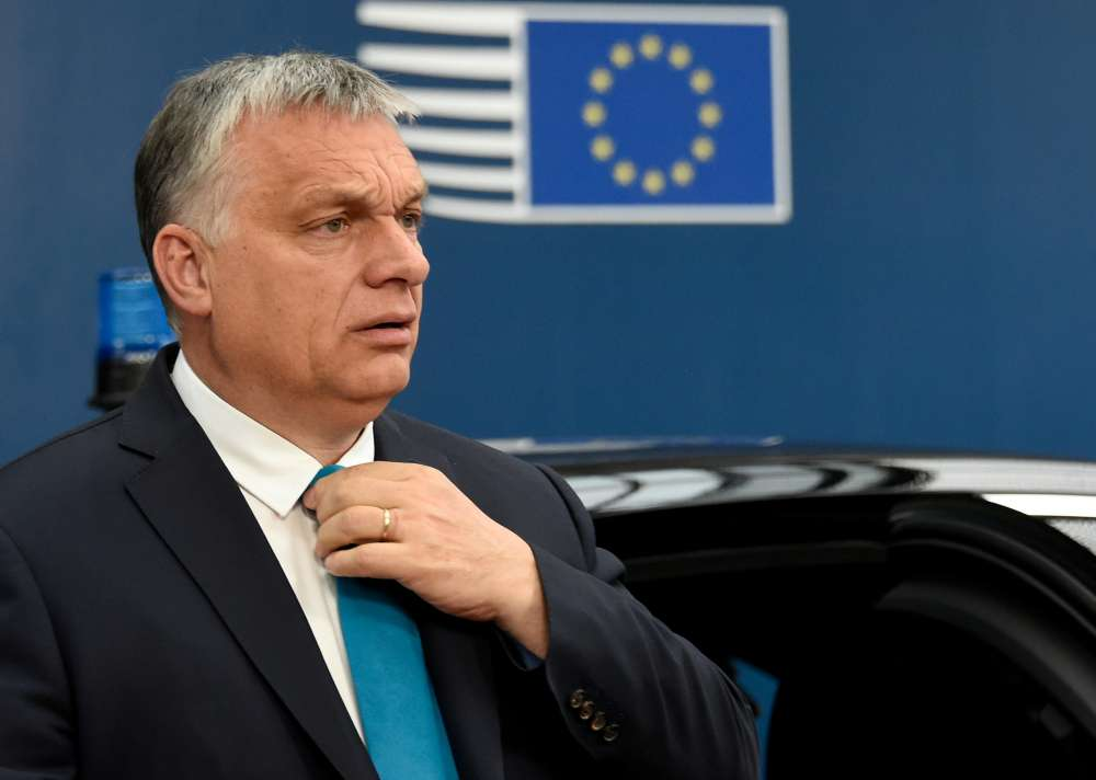 Hungary suspends court reform that worried EU