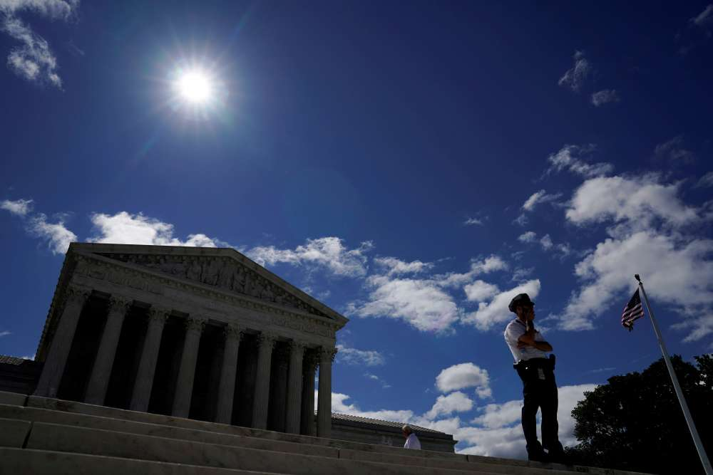 U.S. Supreme Court lets hardline Trump immigration policy take effect