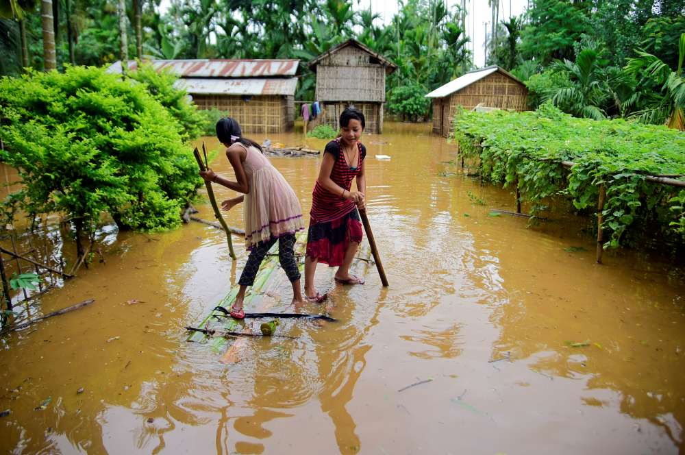 Heavy rain and floods in India's Assam kill at least 10 and displace more than 1 million
