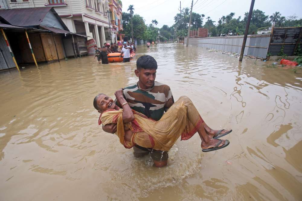 Millions stranded in India as early monsoon downpours bring flood havoc