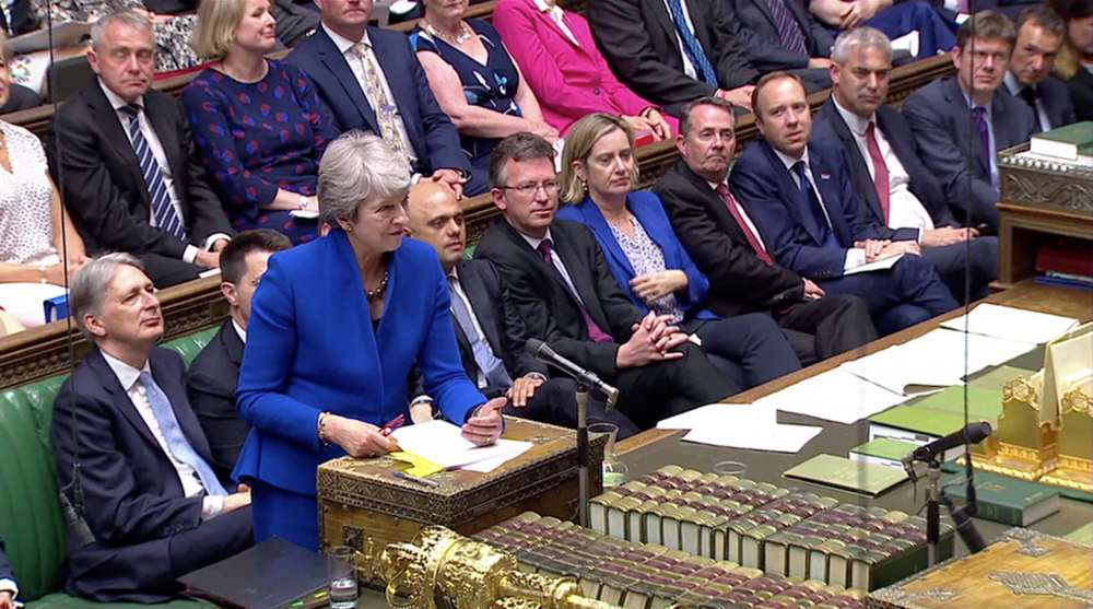UK PM May fights back tears as she is applauded out of parliament