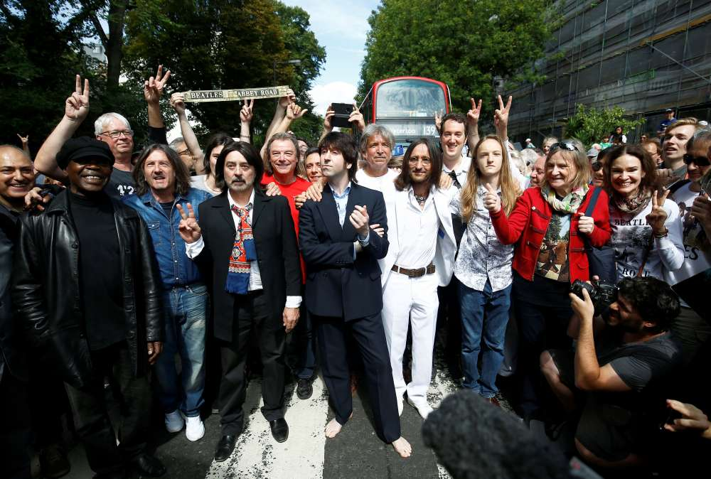 Crowds gather to mark 50th anniversary of the Beatles' Abbey Road album cover photo
