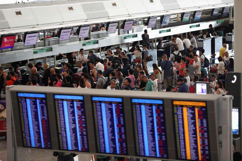Protesters converge at Hong Kong airport to disrupt trave