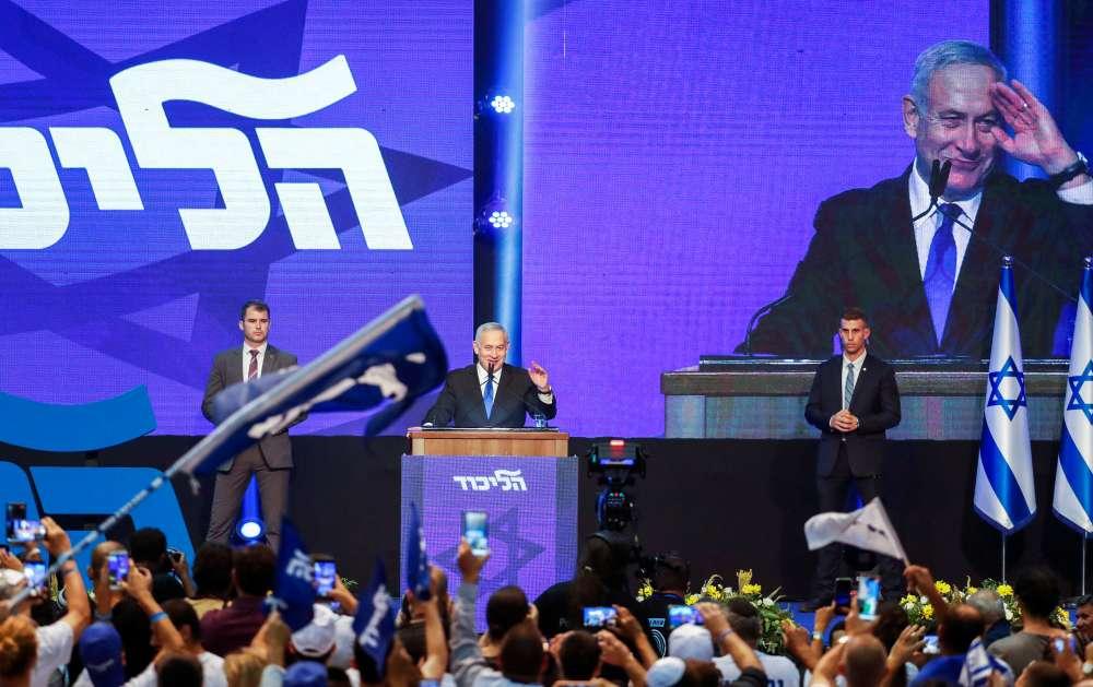 Israel's Netanyahu teetering in close election race - polls
