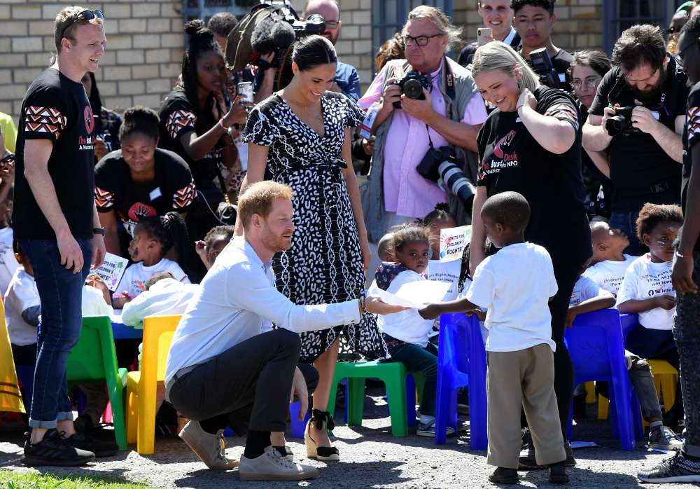 Harry and Meghan arrive in S.Africa on first tour since baby's birth